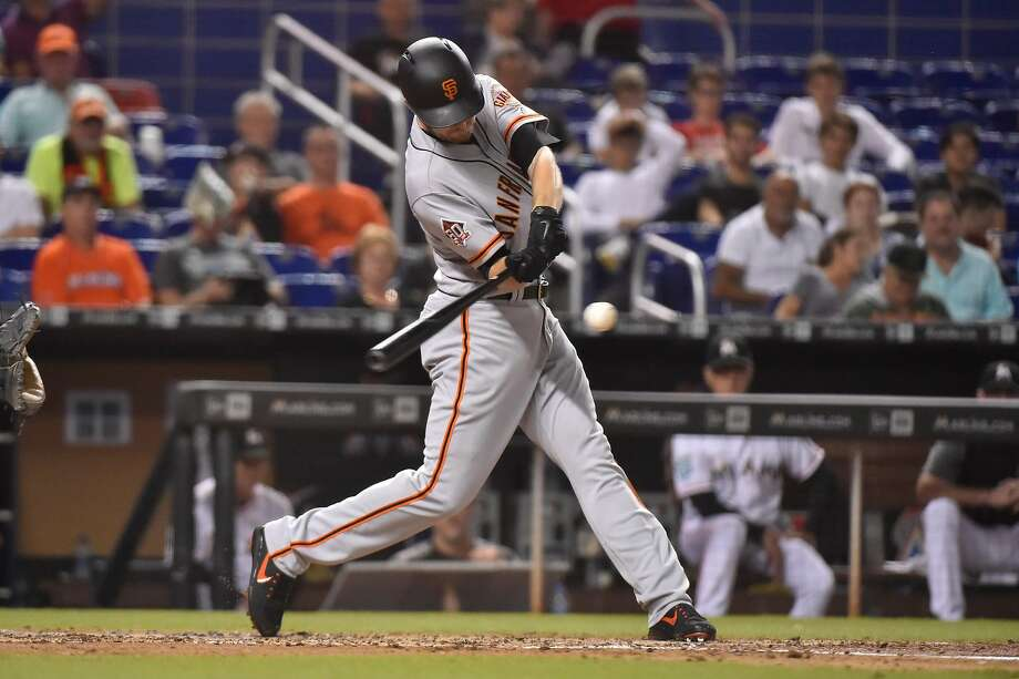 MIAMI, FL - JUNE 12: Chris Stratton #34 of the San Francisco Giants singles int he third inning against the Miami Marlins at Marlins Park on June 12, 2018 in Miami, Florida. (Photo by Eric Espada/Getty Images) Photo: Eric Espada / Getty Images