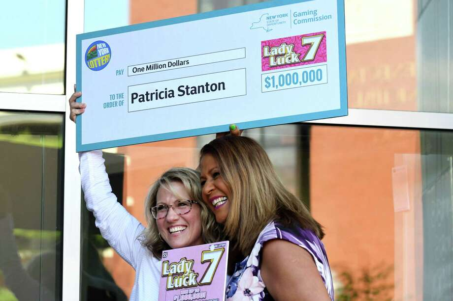 New York Lottery $1 million scratch-off ticket winner Patricia Stanton, left, is presented with a check by Yolanda Vega, right, during an announcement at the New York Lottery Headquarters on Tuesday, June 12, 2018, in Schenectady, N.Y. (Will Waldron/Times Union) Photo: Will Waldron / 40044044A