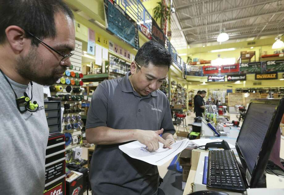 John Cho, Senior Vice President of Empire Tools, right, talks to employee Hector Rodriguez about an order at the store on Tuesday, June 12, 2018, in Houston. Cho's parents came to the U.S. from Korea in 1976 and started the family-owned business in 1977. ( Yi-Chin Lee / Houston Chronicle ) Photo: Yi-Chin Lee / Houston Chronicle / © 2018 Houston Chronicle