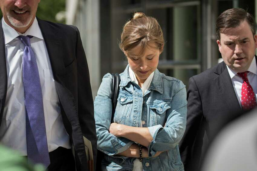 Actress Allison Mack exits the U.S. District Court for the Eastern District of New York following a status conference, June 12, 2018 in the Brooklyn borough of New York City. Mack was charged in April with sex trafficking for her involvement with a self-help organization for women that forced members into sexual acts with their leader. The group, called Nxivm, was led by founder Keith Raniere, who was arrested in March on sex-trafficking charges.