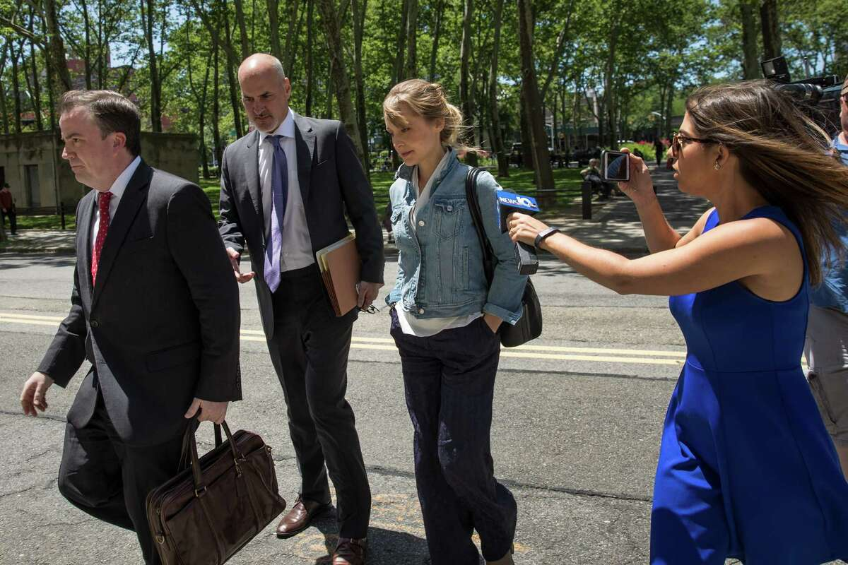 NEW YORK, NY - JUNE 12: Actress Allison Mack arrives at the U.S. District Court for the Eastern District of New York for a status conference, June 12, 2018 in the Brooklyn borough of New York City. Mack was charged in April with sex trafficking for her involvement with a self-help organization for women that forced members into sexual acts with their leader. The group, called Nxivm, was led by founder Keith Raniere, who was arrested in March on sex-trafficking charges. (Photo by Drew Angerer/Getty Images)