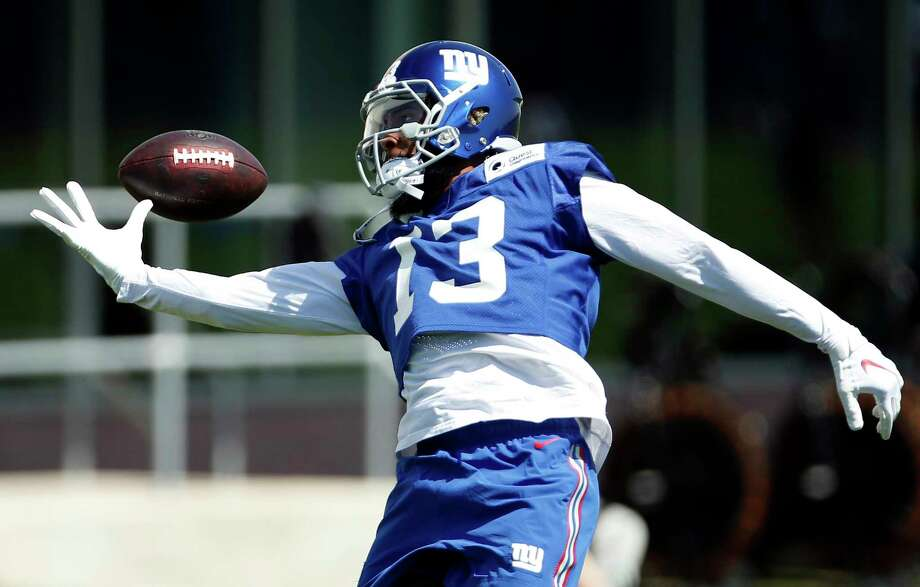 New York Giants wide receiver Odell Beckham attempts to make a catch during the team's NFL football practice, Tuesday, June 12, 2018, in East Rutherford, N.J. (AP Photo/Adam Hunger) Photo: Adam Hunger / FR110666 AP