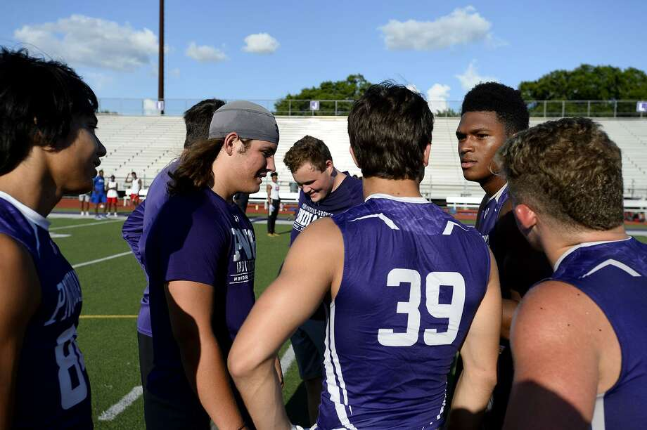 Port Neches-Groves quarterback Roschon Johnson, right, calls a play during a 7-on-7 game against West Brook at Indian Stadium.