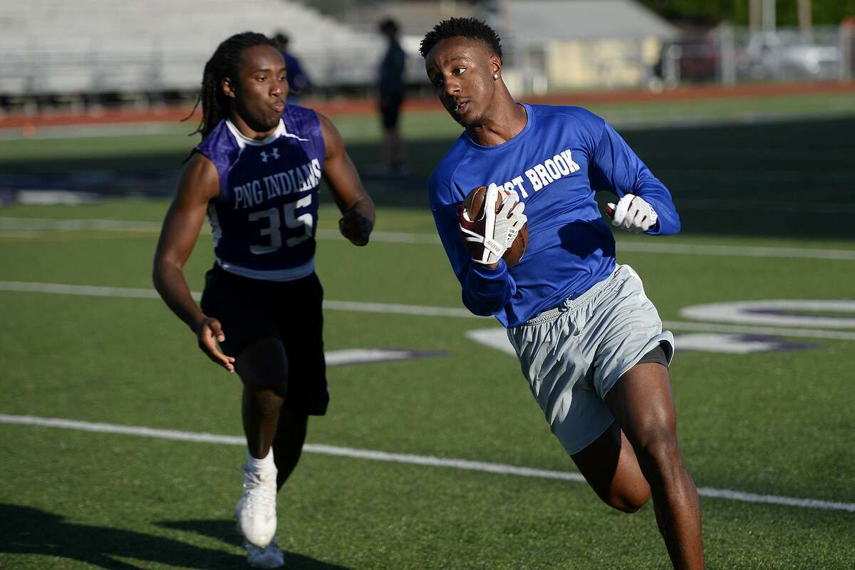 West Brook's Deonte Simpson carries the ball in a 7-on-7 football game against Port Neches-Groves at Indian Stadium. Photo taken Tuesday 6/12/18 Ryan Pelham/The Enterprise