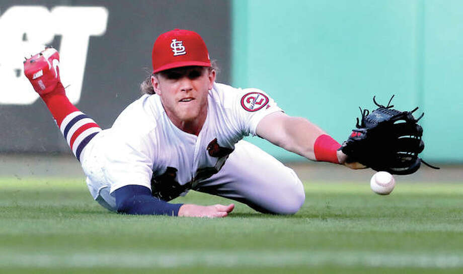 Cardinals right fielder Harrison Bader's diving bid to catch a fly ball by San Diego's Jose Pirela comes up short Tuesday night at Busch Stadium. Photo:     Jeff Roberson | AP Photo