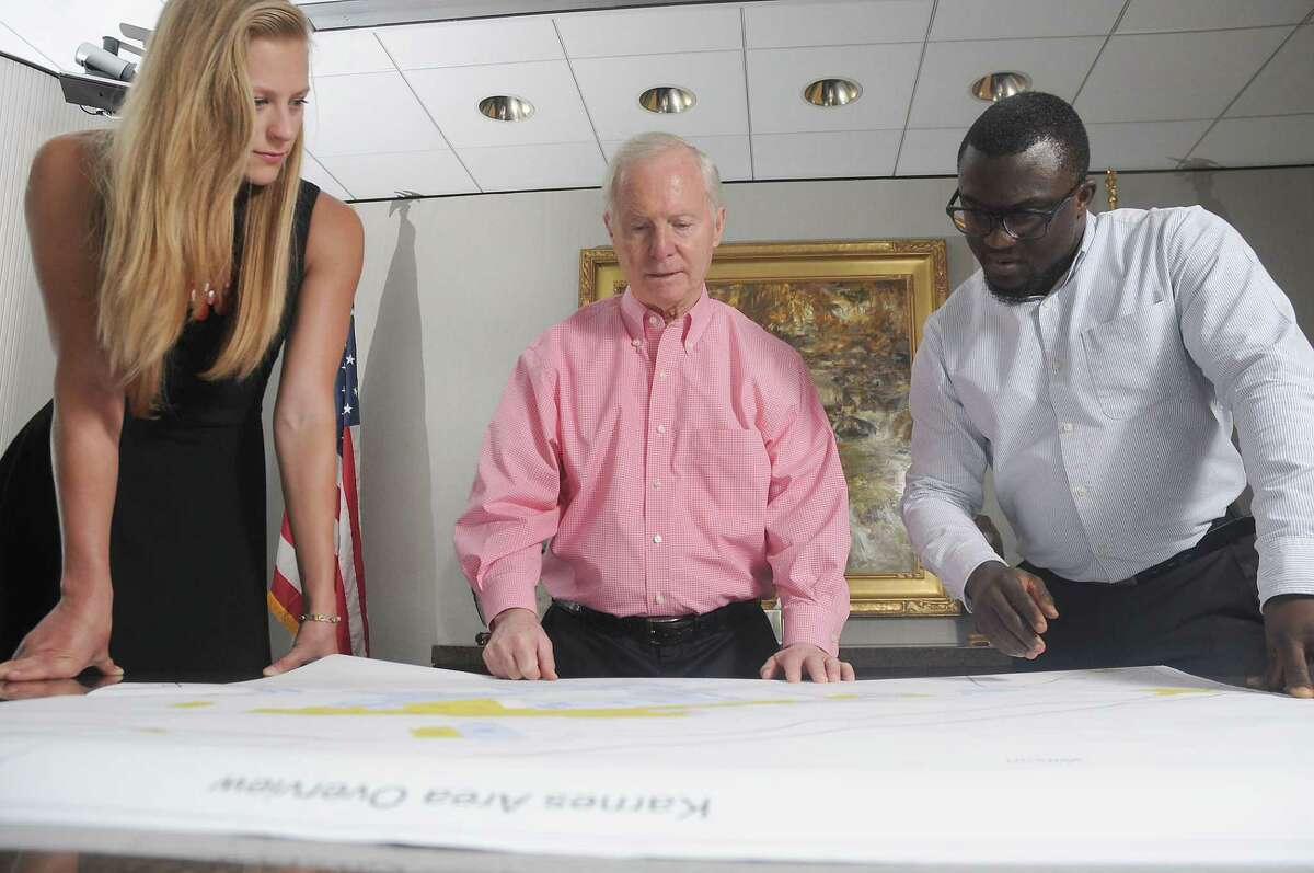 EnerVest CEO John Walker,center, works Geoscience tech Maria Wedding, at left, and geologist Bisi Ajiboye at the company's headquarters downtown Tuesday May 8 ,2018.(Dave Rossman Photo)