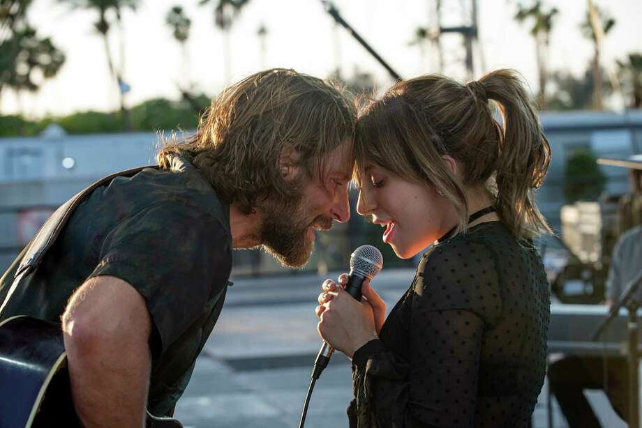"This image released by Warner Bros. shows Bradley Cooper, left, and Lady Gaga in a scene from the latest reboot of the film, ""A Star is Born."" Barbara Streisand is giving an early thumbs-up to the remake of ""A Star Is Born"" with Lady Gaga and Bradley Cooper. Streisand and Kris Kristofferson topped the 1976 version of the romantic drama about a rising performer and a fading star.  (Neal Preston/Warner Bros. via AP) Photo: Neal Preston / © 2017 Warner Bros. Entertainment Inc."