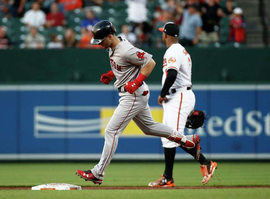 Boston Red Sox's Andrew Benintendi, left, rounds the bases past Baltimore Orioles second baseman Jonathan Schoop after hitting a solo home run during the third inning of a baseball game Tuesday, June 12, 2018, in Baltimore. (AP Photo/Patrick Semansky) Photo: Patrick Semansky / Copyright 2018 The Associated Press. All rights reserved.