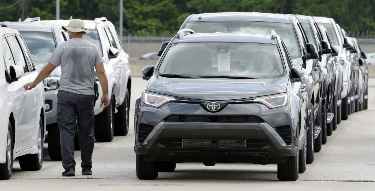 Various models of Toyota vehicles are lined up to be loaded onto car haulers (trailers, commonly known as portable parking lots) to be taken to dealerships at the Gulf States Toyota vehicle processing facility Wednesday, May 23, 2018, in Houston, TX. The facility averages around 6000 toyota vehicles on the lot at anytime being prepped and processed before being sent to Toyota dealerships. (Michael Wyke / For the Chronicle)