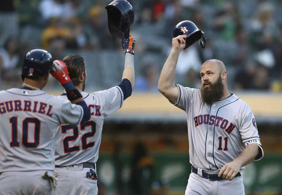 It's hats off to Evan Gattis, right, after his three-run in the second inning Tuesday night. The Astros' designated hitter added a two-run double in the fifth. Photo: Ben Margot, STF / Associated Press / Copyright 2018 The Associated Press. All rights reserved.