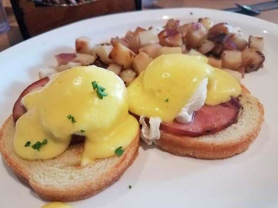 Eggs Benedict featuring poached eggs, Canadian bacon atop English muffins and covered with hollandaise sauce is on the menu at de Boer's Bakkerij and Restaurant, 360 Douglas Avenue in Holland, Michigan. (Matthew Woods | for the Daily News)