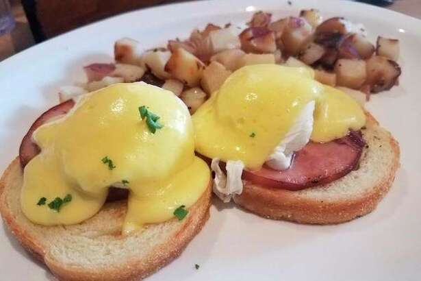 Eggs Benedict featuring poached eggs, Canadian bacon atop English muffins and covered with hollandaise sauce is on the menu at de Boer's Bakkerij and Restaurant, 360 Douglas Avenue in Holland, Michigan. (Matthew Woods   for the Daily News)