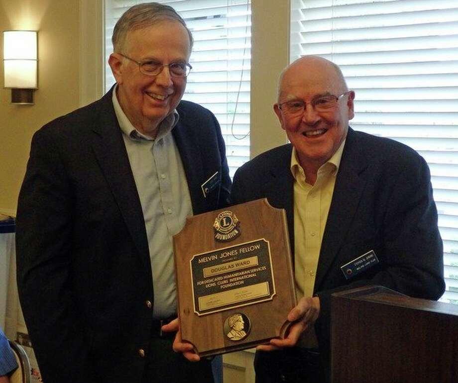 Doug Ward, left, receives the Melvin Jones award from Midland Lions President Steve Jenkins at the 85th Midland Lions Annual Award Ceremony.