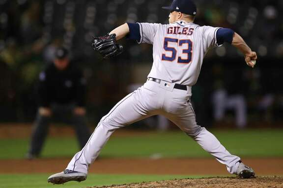 Houston Astros pitcher Ken Giles works against the Oakland Athletics during the ninth inning of a baseball game Tuesday, June 12, 2018, in Oakland, Calif. (AP Photo/Ben Margot)