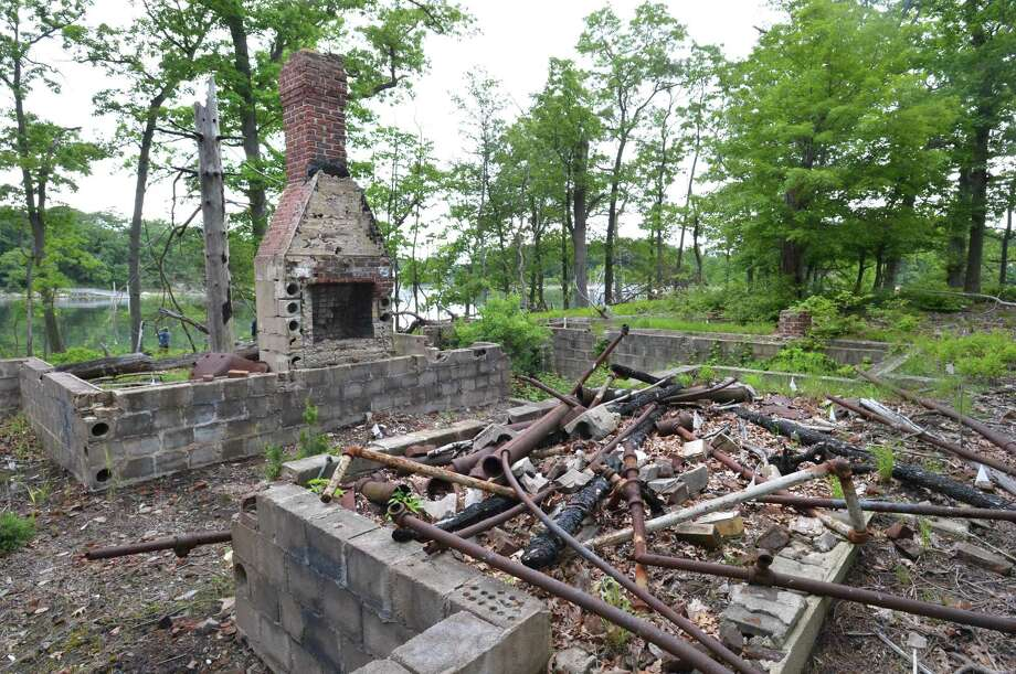 The remains of a caretakers cottage on Wednesday June 6, 2018 in Norwalk Conn that burned down on Hoyt Island between Wilson Point and Village Creek. The Norwalk Land Trust will receive $100,000 state grant to clean up contamination on Hoyt Island and preserve the 3-acre tract as a sanctuary for migrating birds and other wildlife. Photo: Alex Von Kleydorff / Hearst Connecticut Media / Norwalk Hour