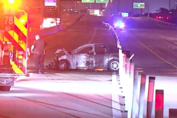 A car caught fire after a crash on the Katy Freeway, near Memorial, on Wednesday, June 13, 2018.