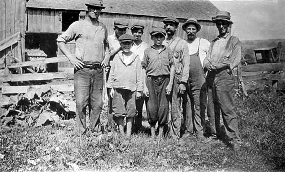 "Edgar Bostwick and fellow tobacco farms pose for posterity in the 1920s in New Milford. If you have a ""Way Back When"" photograph you'd like to share, contact Deborah Rose at drose@newstimes.com or 860-355-7324. Photo: Courtesy Of Bette Lou Emmons / The News-Times Contributed"
