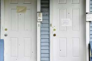 Bullet holes riddle the front doors of the Livingston Avenue building where 20-year-old Equan Fallen was gunned down on Tuesday. Albany police said he died at Albany Medical Center Hospital after he was shot at 448 Livingston Ave.