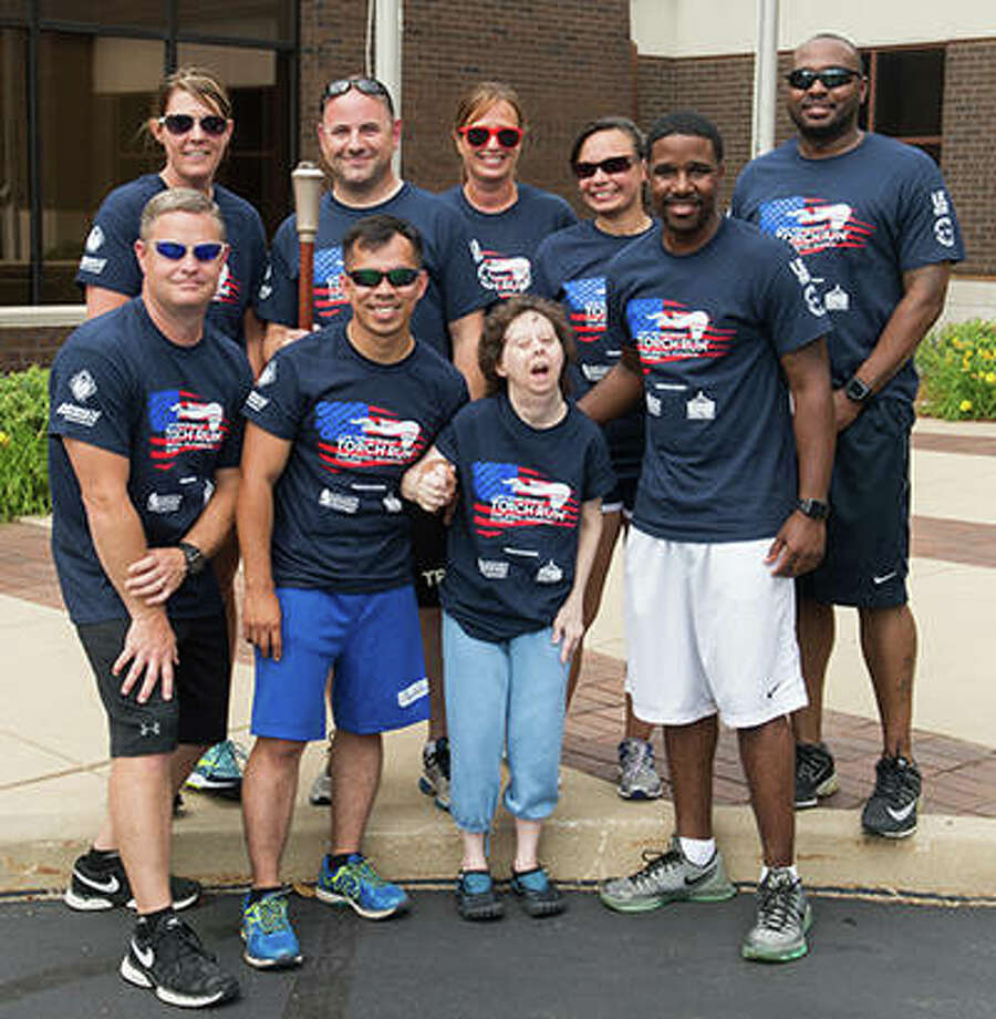 SIUE police officers participated in the annual Law Enforcement Torch Run. Back row from left to right: Lisa Johnson, John Cavanaugh, Kathleen Pont, Maria Ferrari and Anthony Jones. Front row from left to right: Adam Severit, Xac Vo, Lisa Newbury (Special Olympian) and Kasey Hoyd. Photo:       For The Telegraph