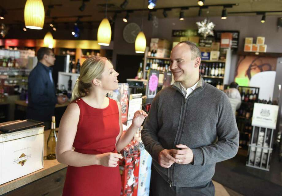 Bom Bom founder Eva Maria Janerus and Kevin Mowers in February 2018, with bottles of Bom Bom Coco Mochanut and Nilli Vanilli at A1 Cellars Wine and Spirits in Greenwich, Conn. Photo: Tyler Sizemore / Hearst Connecticut Media / Greenwich Time