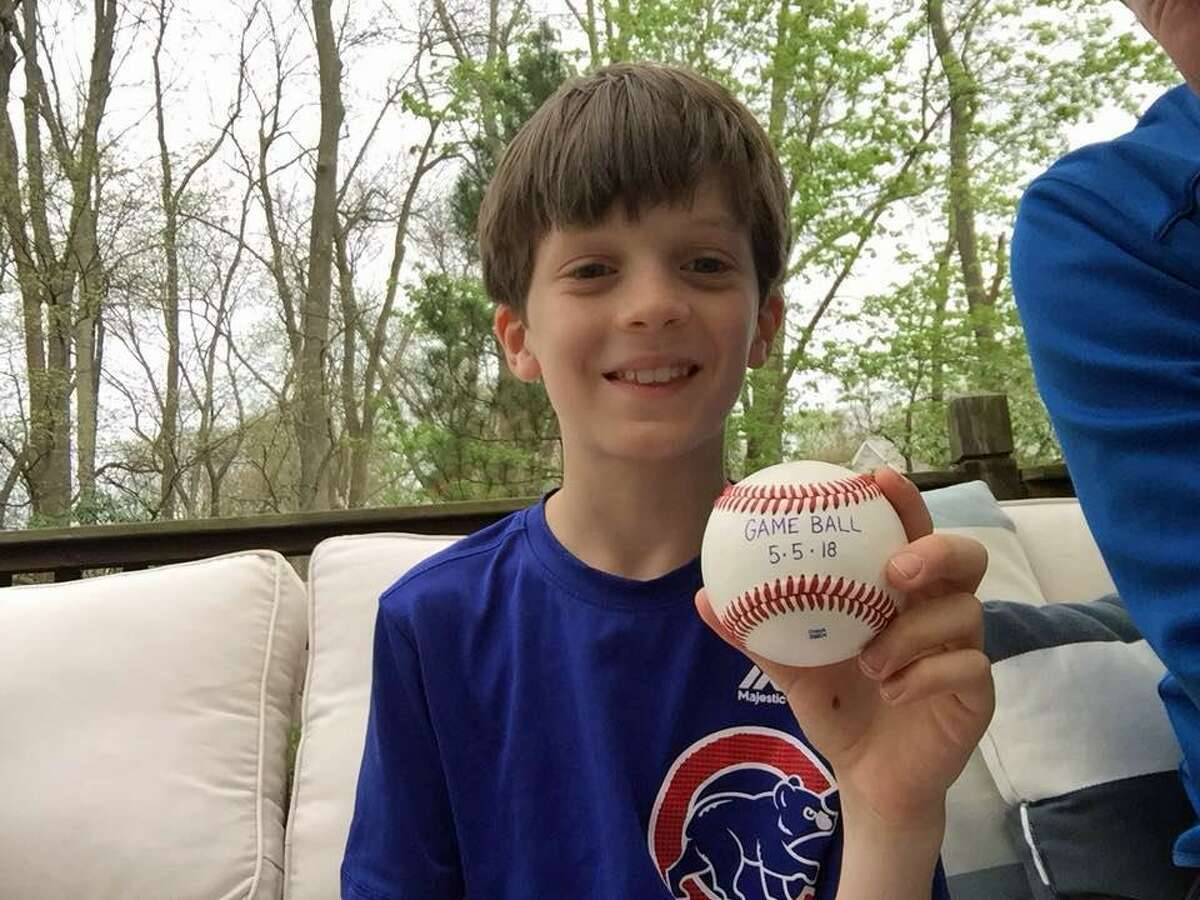 Perrin Delorey, 10, of Westport, holding a game ball he was awarded after a May 5 Little League Game.