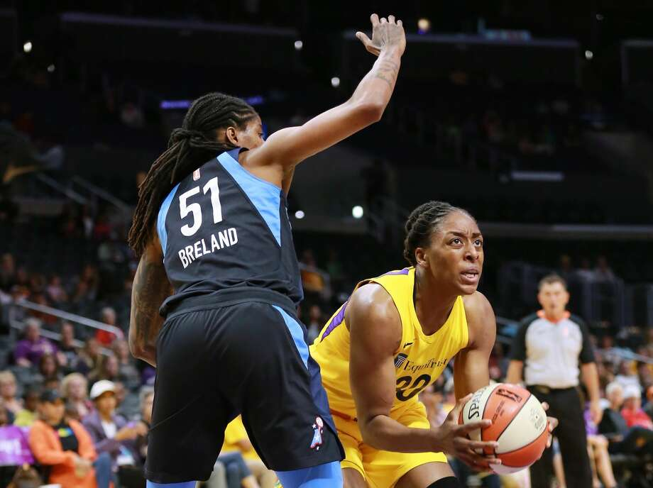 LOS ANGELES, CA - JUNE 12:  Nneka Ogwumike #30 of the Los Angeles Sparks handles the ball against Jessica Breland #51 of the Atlanta Dream during a WNBA basketball game at Staples Center on June 12, 2018 in Los Angeles, California.  (Photo by Leon Bennett/Getty Images) Photo: Leon Bennett/Getty Images