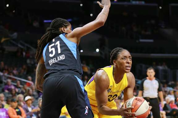 LOS ANGELES, CA - JUNE 12:  Nneka Ogwumike #30 of the Los Angeles Sparks handles the ball against Jessica Breland #51 of the Atlanta Dream during a WNBA basketball game at Staples Center on June 12, 2018 in Los Angeles, California.  (Photo by Leon Bennett/Getty Images)