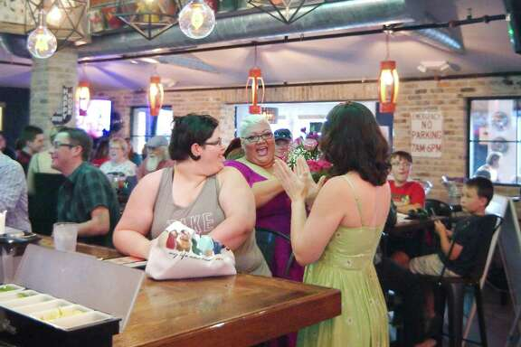 'America's Got Talent' contestant Christina Wells, center, chats with friends Keeley Hard, left, and Alli Villines at a viewing party at Spanky's Pizza in Pasadena for the June 5 broadcast of Wells' performance on the program.