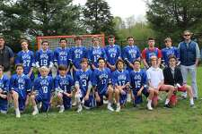 New Canaan Country School's boys' varsity lacrosse team finished the season with a 12-0 final record. Members of the team included (front row, from left to right) Will Johnson of Darien, Jackson Alpaugh of Darien, Charlie Gaynor of Bedford, NY, Cody Comyns of New Canaan, Owen Collins of Darien, Jeffrey Ricciardelli of New Canaan, Rett Zeigler of Rowayton, Walker Blair of New Canaan, Carter Spain of New Canaan, (top row, left to right) Assistant Coach Mr. Furbee, Nick Lancaster of Darien, Peter Diorio of West Redding, Ram Perez of Norwalk, Alex Byrne of Darien, Carter Alvord of New Canaan, Alex Sotirhos of New Canaan, Tyler Galante of Darien, Thomas Ricciardelli of New Canaan, James Kontulis of New Canaan, Assistant Coach Mr. Johnson and Head Coach Mr. Khuen.