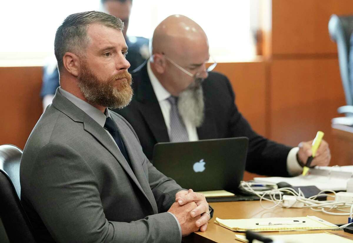 Terry Thompson, accused of fatally choking John Hernandez, left, is shown in court with his attorney Greg Cagle, right, Wednesday, June 13, 2018 in Houston. Terry and his wife Chauna Thompson, a former Harris County Sheriff's deputy, are charged with murder in the chokehold death of John Hernandez at a Denny's.
