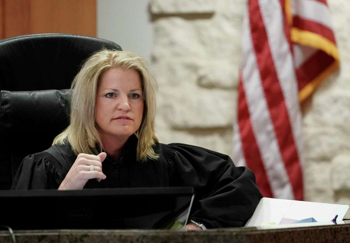 Judge Kelli Johnson, of the 178th District Criminal Court, speaks to the jury during the trial of Terry Thompson, who is accused of fatally choking John Hernandez, shown Wednesday, June 13, 2018 in Houston. Terry and his wife Chauna Thompson, a former Harris County Sheriff's deputy, are charged with murder in the chokehold death of John Hernandez at a Denny's.