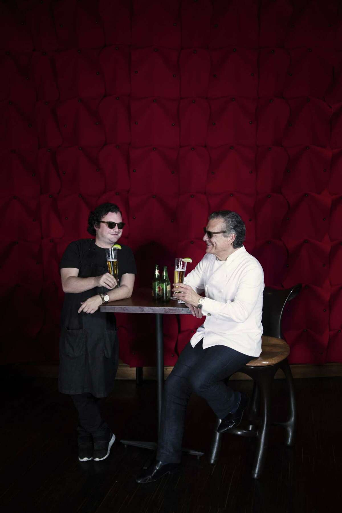 David Cordúa and his father Michael Cordúa share a beer at their restaurant Américas.