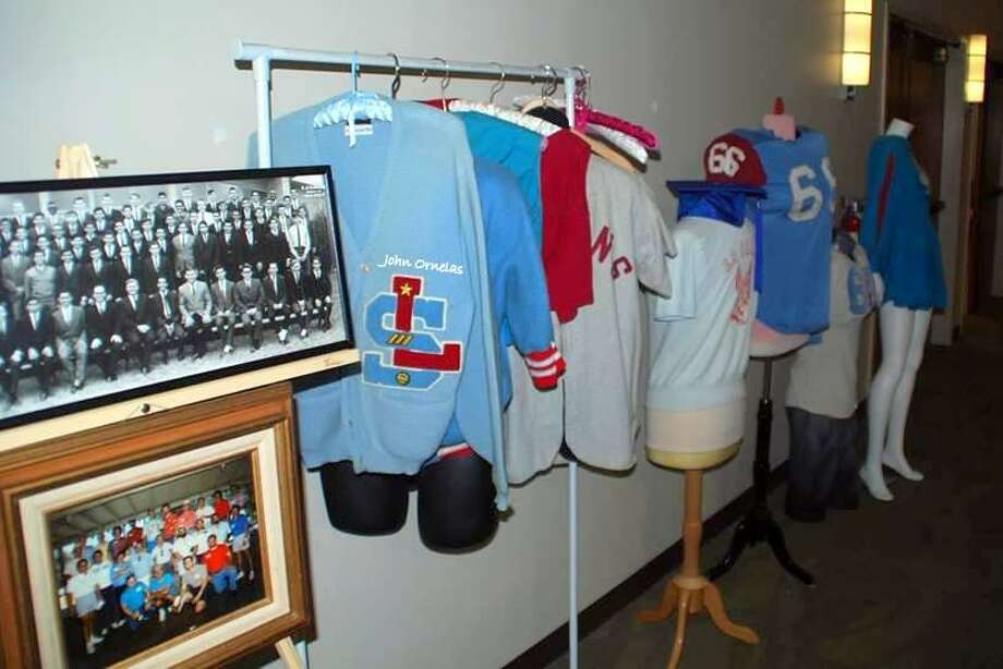 Graduates of La Salle High School, a now-closed Catholic school for boys that operated on the South Side from 1957 to 1968, exhibited archival photos and garments at its recent reunion. Photo: Courtesy / Courtesy