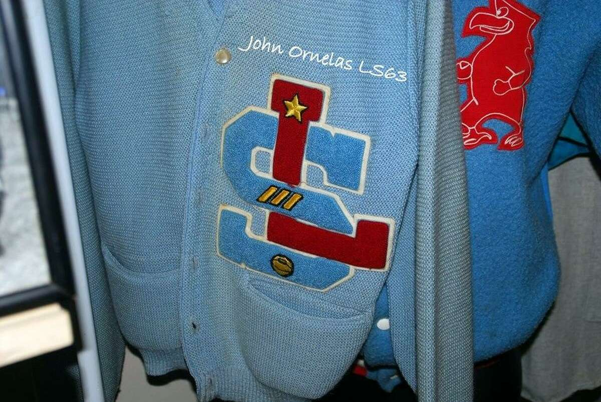 A sweater from a graduate of La Salle High School, a now-closed Catholic school for boys that operated on the South Side from 1957 to 1968, which recently celebrated a reunion
