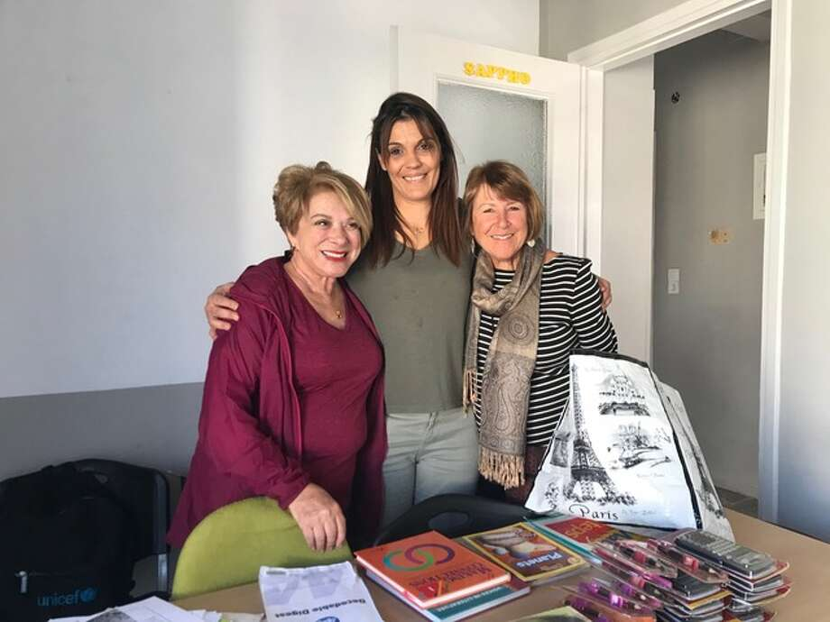 """Bay Area residents Barbara Karvelis (left) and Cecelia Wambach (right) pose with a Greek teacher working to help refugee children on the island of Lesbos. Wambach from Rossmoor and Karvelis from Redwood City are part of a Bay Area group of former educators who are """"reinventing their retirement"""" by providing classroom support to refugee children in Greece. Photo: Courtesy Of Barbara Karvelis"""