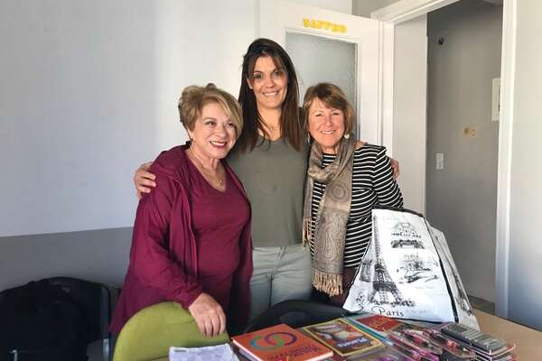 Bay Area residents Barbara Karvelis (left) and Cecelia Wambach (right) pose with a Greek teacher working to help refugee children on the island of Lesbos. Wambach and Karvelis are part of a local group of former educators who are providing classroom support to refugee children in Greece.