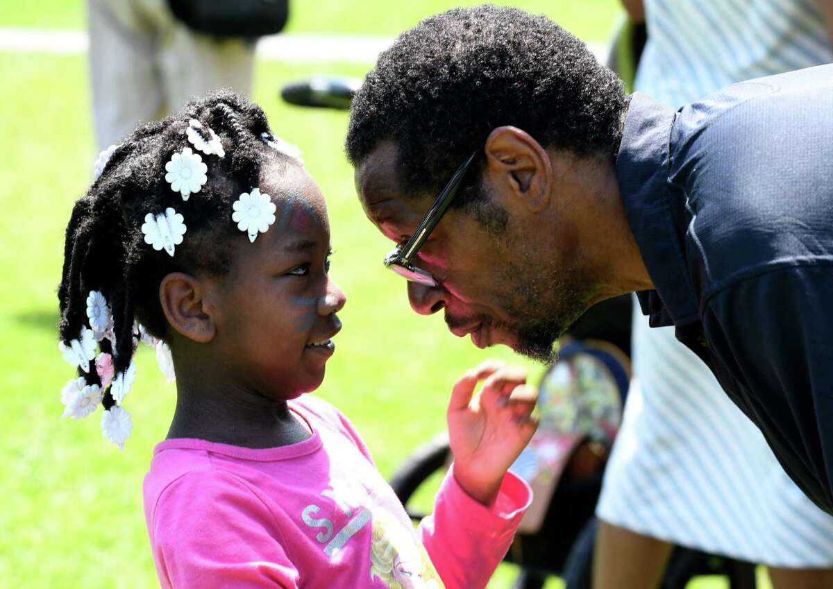 Rosalane Knox, 7, of Albany nuzzles up to her father, Donald, during Dad Fest in Washington Park on Sunday, June 18, 2017, in Albany, N.Y. The free Father?'s Day event featured live music, food vendors and activities. (Will Waldron/Times Union)