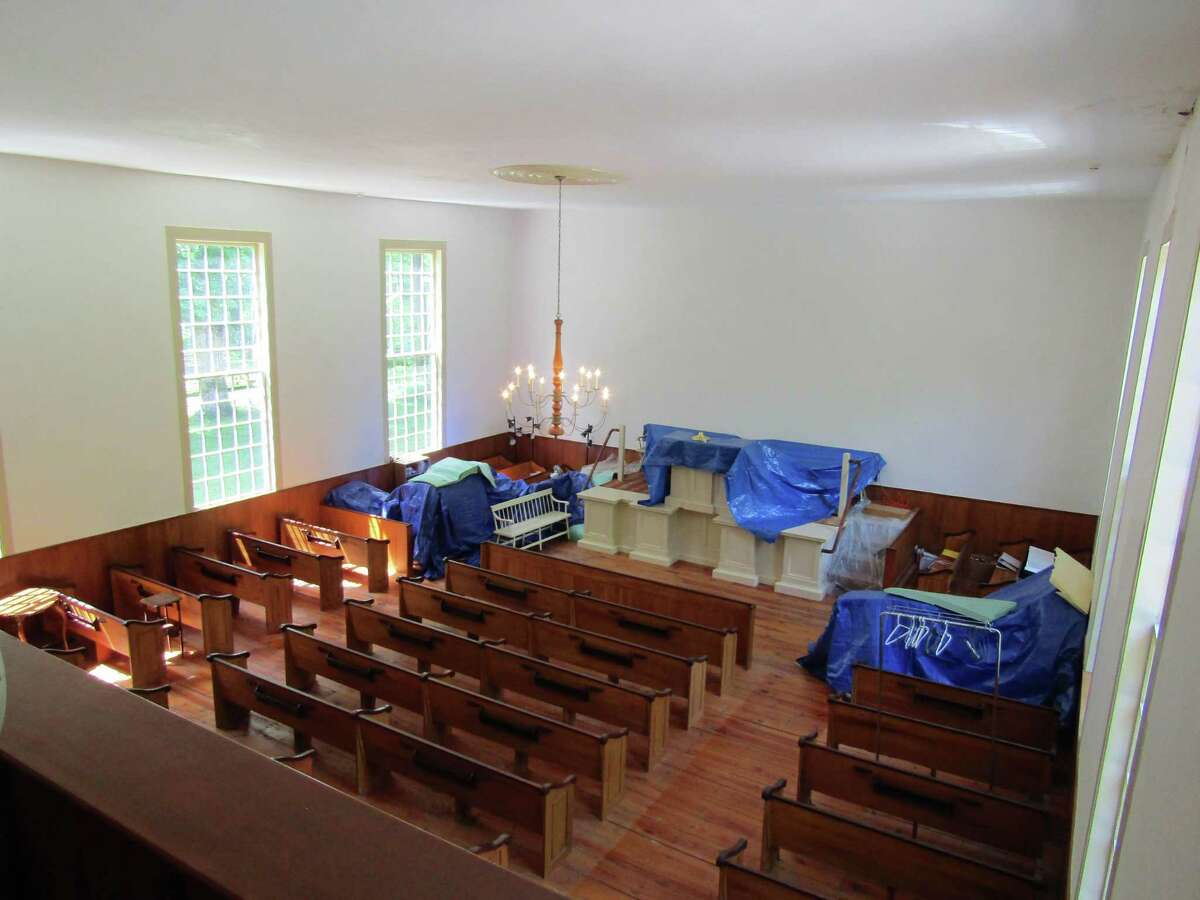 The First Congregational Church in Barkhamsted will unveil its renovated sanctuary and exterior building on Sunday. Pictured is the sanctuary during construction in May, and the completed renovation in June.
