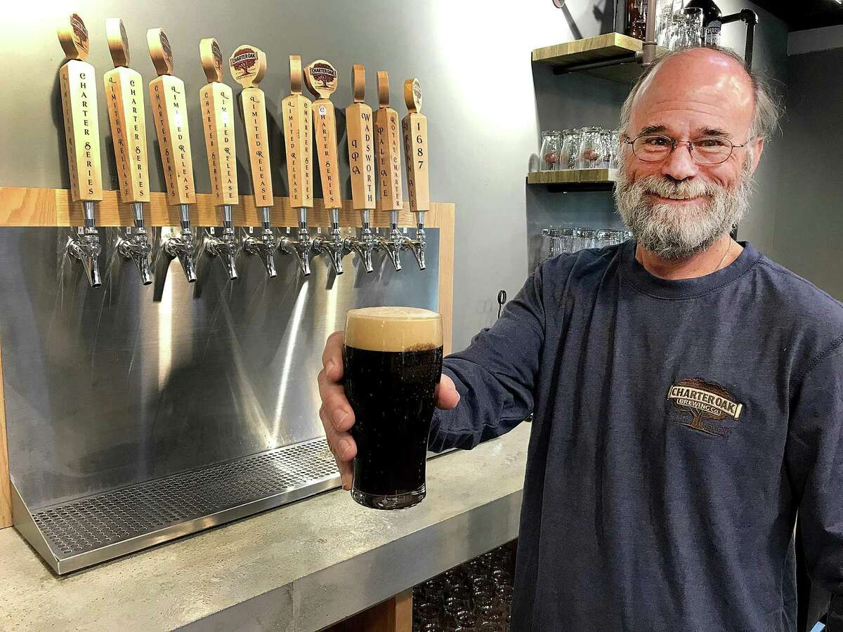 Scott Vallely, owner of Charter Oak Brewing, stands in the brewery's new taproom in Danbury, Conn., on Wednesday, June 13, 2018.