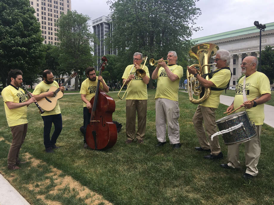 The state's teachers' union used musicians to draw attention to their legislative push on Wednesday outside the Capitol. Photo: By David Lombardo