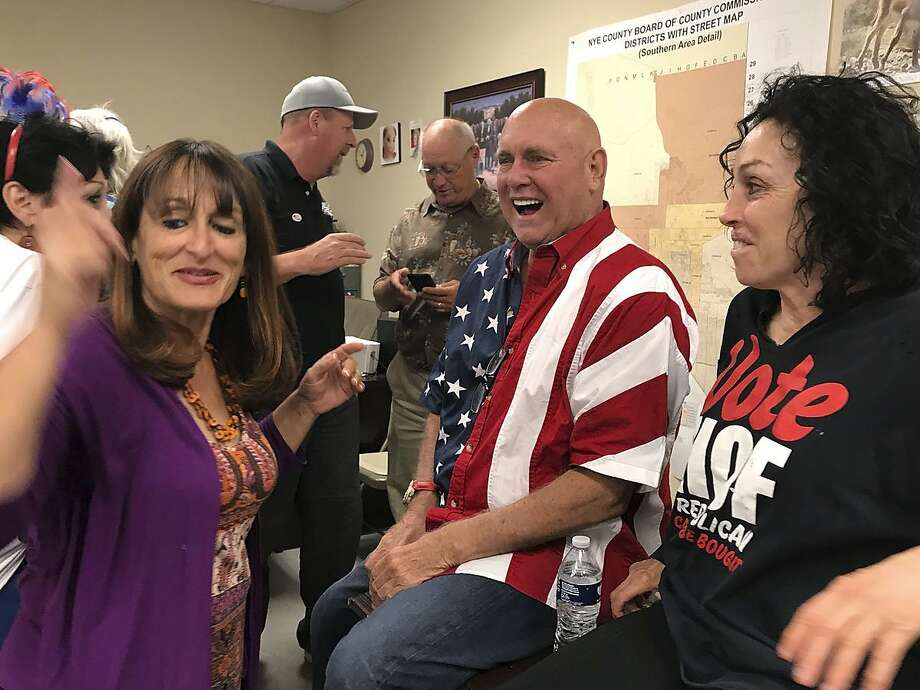 Nevada brothel owner Dennis Hof (second from right) celebrates after winning the Republican primary for the state Legislature in Pahrump, Nev. Hof owns half a dozen legal brothels. Photo: David Montero / Associated Press