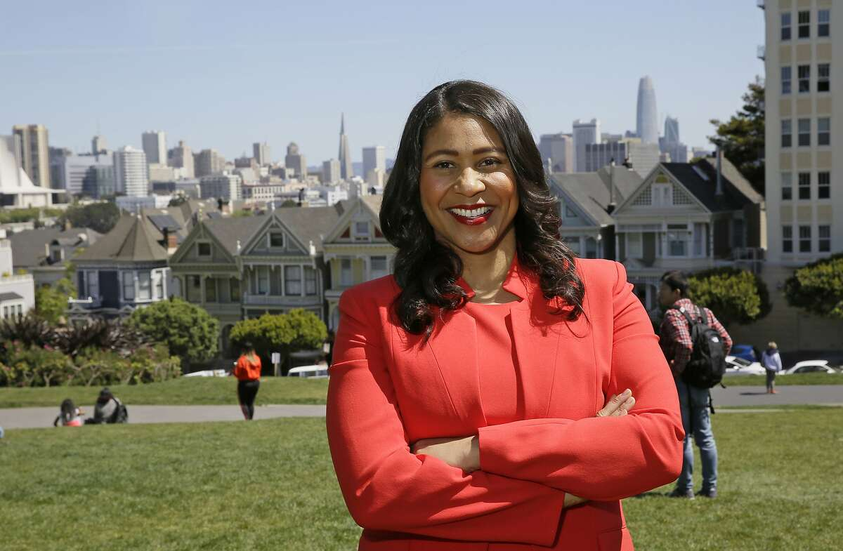 FILE - In this file photo taken Friday, April 13, 2018, San Francisco mayoral candidate and Board of Supervisors President London Breed poses for a photo at Alamo Square in San Francisco. San Francisco voters are electing a new mayor in a contest hastily placed on the June 5 ballot after the unexpected death of Mayor Ed Lee in December. San Francisco could make history by electing its first African-American woman, Asian-American woman or openly gay man for mayor. The city has enormous wealth thanks to a flourishing economy led by the tech industry, but it's also plagued by rampant homelessness. This mayor's race is the city's first competitive mayoral race in 15 years. (AP Photo/Eric Risberg, File)