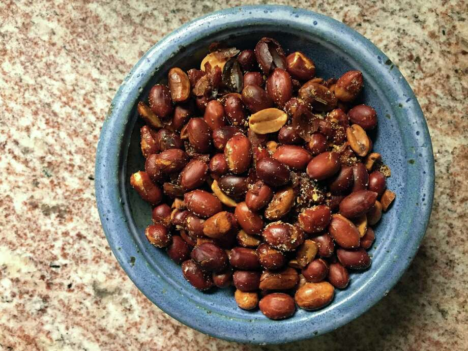 Spicy and sweet peanuts with Sichuan peppercorns are easy to make at home. Photo: Paul Stephen / San Antonio Express-News