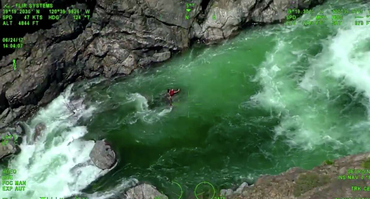 A newly released video shows personnel rescuing a swimmer stuck on a small rock in the middle of the Yuba River on June 24, 2017.
