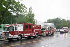 Firefighters respond to an oil leak at the Audi dealership on West Putnam Avenue in Greenwich, Conn. Wednesday, June 13, 2018. Crews were dispatched to contain oil leaking from a waste-oil container and prevent any spillage into local waterways.