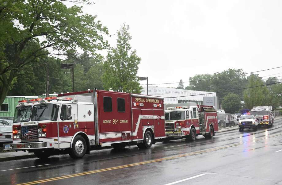 Firefighters respond to an oil leak at the Audi dealership on West Putnam Avenue in Greenwich, Conn. Wednesday, June 13, 2018. Crews were dispatched to contain oil leaking from a waste-oil container and prevent any spillage into local waterways. Photo: Tyler Sizemore / Hearst Connecticut Media / Greenwich Time