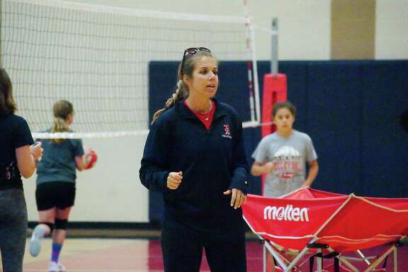 Dawson volleyball coach Lauren Leth observes a drill at the Dawson summer volleyball camp Tuesday, June 12.