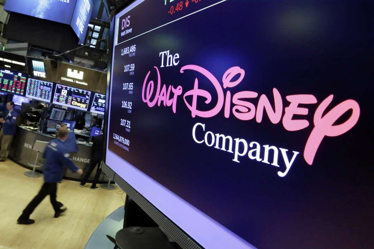 In this Aug. 8, 2017, photo, The Walt Disney Co. logo appears on a screen above the floor of the New York Stock Exchange.