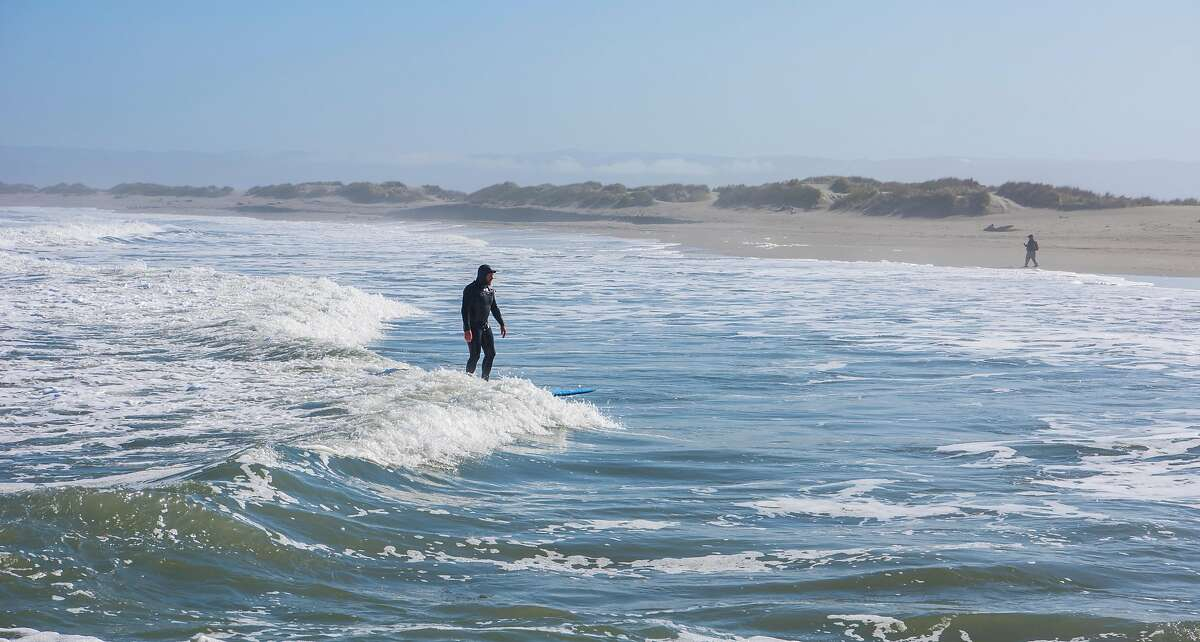 Surfing is a popular activity at Samoa Dunes along the north jetty at Humboldt Bay near Eureka.