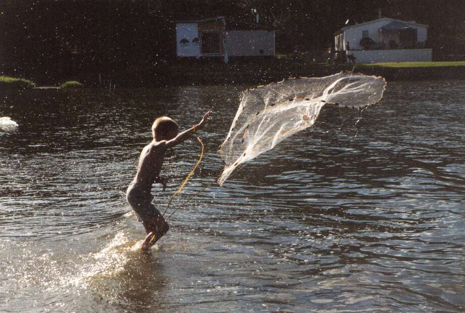 LeBlanc's grandson catching bait on Lake Conroe with a cast net in the early morning. Photo: Larry J. LeBlanc